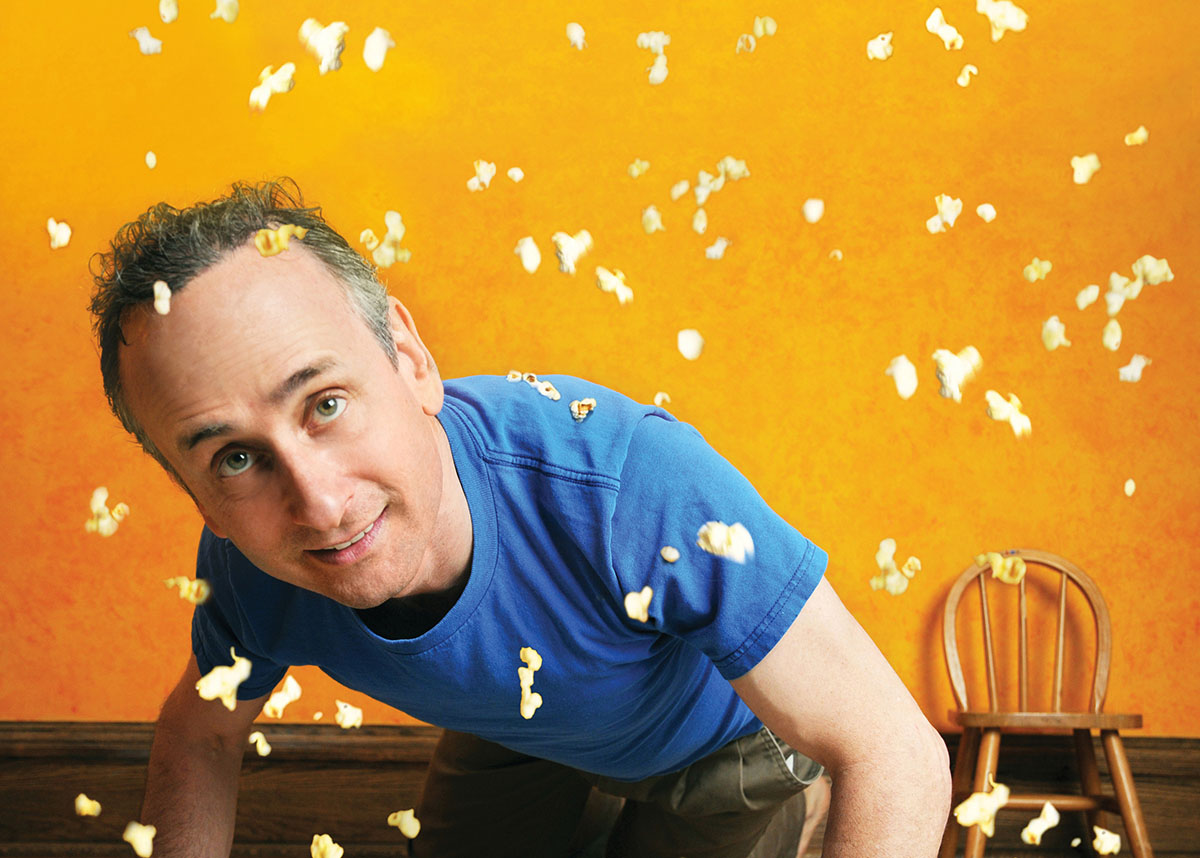 Canadian actor/director Alon Nashmon with popcorn kernels falling around him.